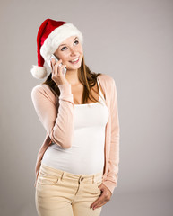 Beautiful woman with christmas hat