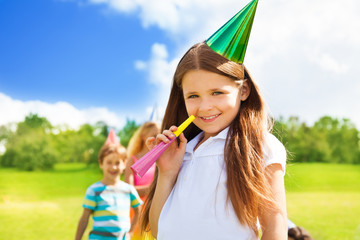 Happy smiling girl on birthday party