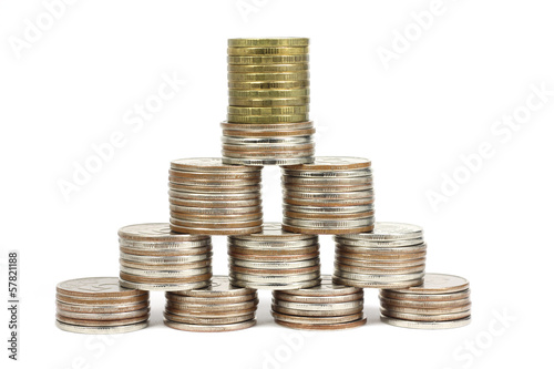 Stacks of coins stacked in a pyramid on a white background