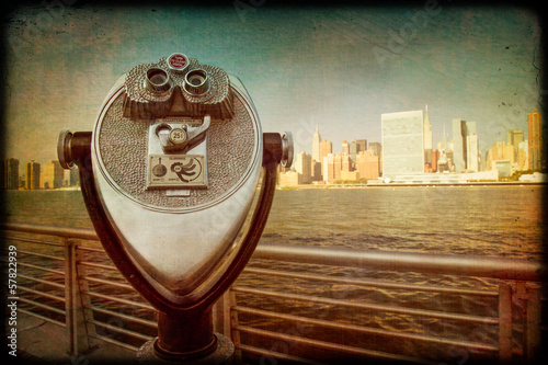 Retro image of coin operated binoculars with view of NYC