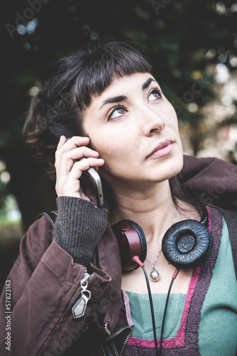beautiful young woman calling