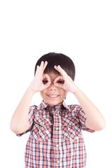 young boy peeking through hand