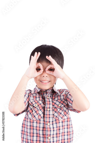young boy peeking through hand