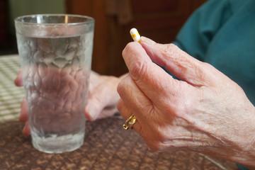 Senior Citizen Holding Medication