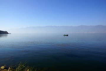 People fishing on Erhail lake, Dali, Yunnan province, China