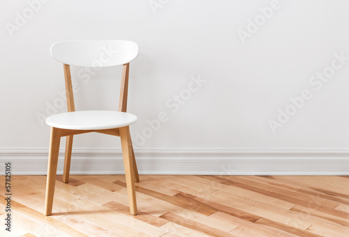 White chair in an empty room - 57825105