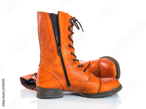 Orange leather boots on white background