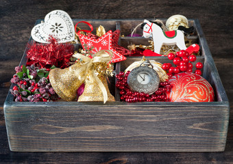 Wooden box with Christmas toys and decorations