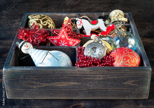 Wooden box with Christmas toys, gifts and decorations