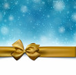 Christmas blue background with golden bow.