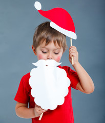 Little boy in Santa hat.