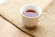 cup of tea over wooden background