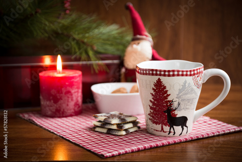 Christmas mug with cookies and  decorations.