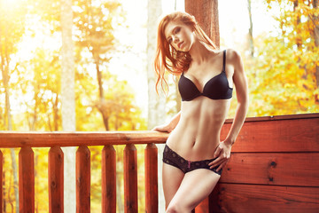 sexy redhead in bra and panties on cabin deck