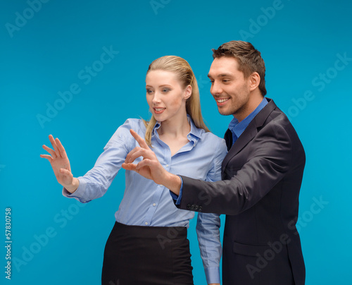 woman and man working with virtual screen