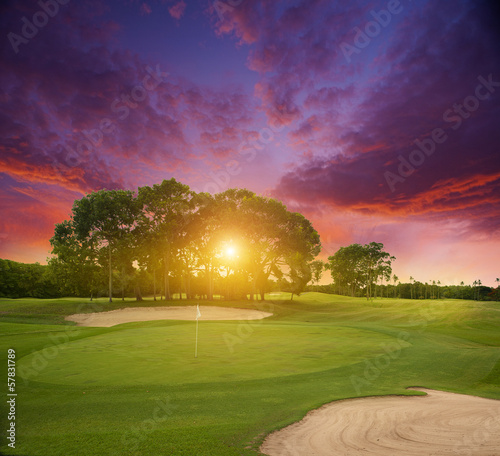 Sunset over a field of golf