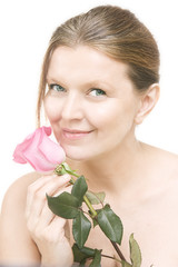 attractive mid adult woman with a pink rose , female face of bea