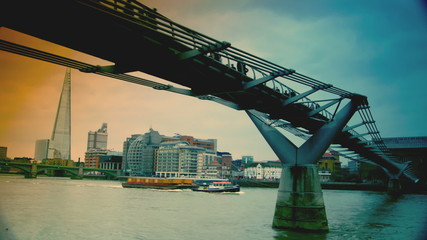 View of Millennium Bridge and Shard from Thames river