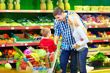 candid portrait of family buying food in supermarket