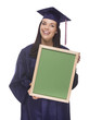 Mixed Race Female Graduate in Cap and Gown Holding Chalkboard.