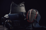 Kendo protection gear, horizontal shot, dark background