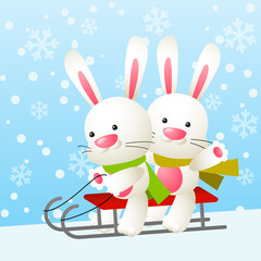 Cute white rabbits on a sled