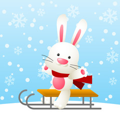 Cute white rabbit on a sled