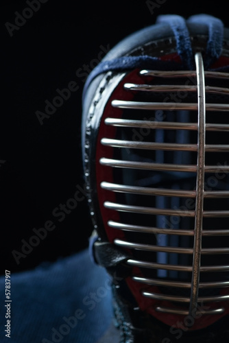 Close-up of kendo helmet, black background, studio shot