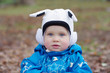 portrait of lovely baby in white hat outdoors