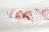 newborn in white knitted hat