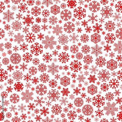 Christmas seamless pattern of small red snowflakes