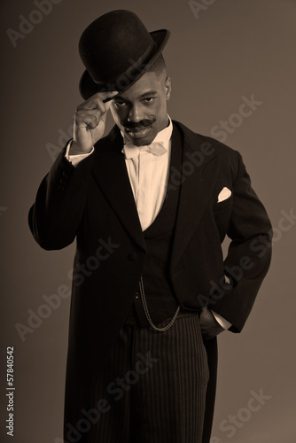 Retro afro american 1900 style man with mustache. Wearing black