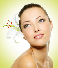 Beauty face of young beautiful woman with flower