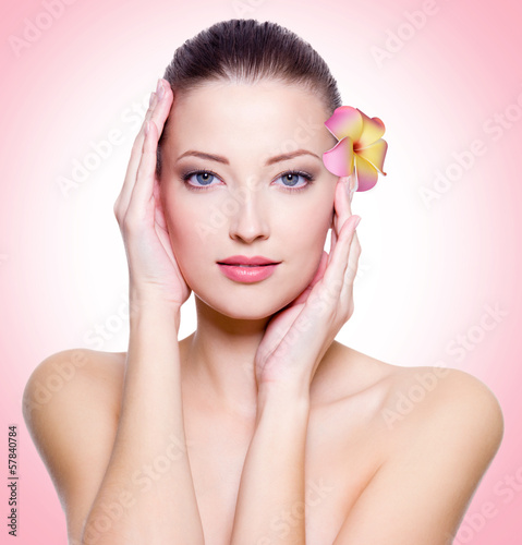 young woman with healthy clean skin of face