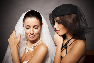 Sexy lesbian couple wearing veils