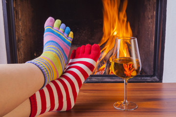 relaxing at fireplace in colorful funny toesocks