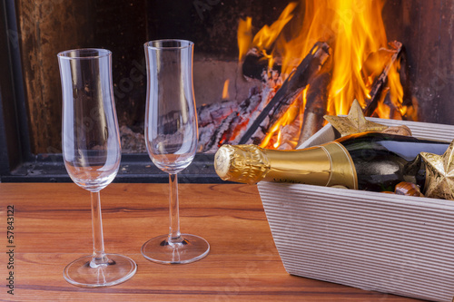 champagne for two at cozy fireplace