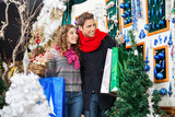 Young Couple Shopping At Christmas Store