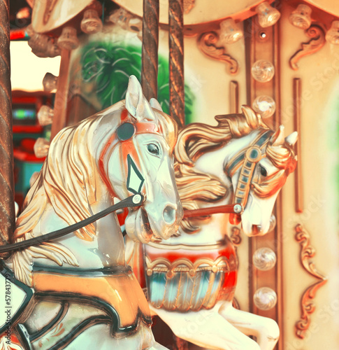 Carousel -  Fair conceptual background with horses in vintage to