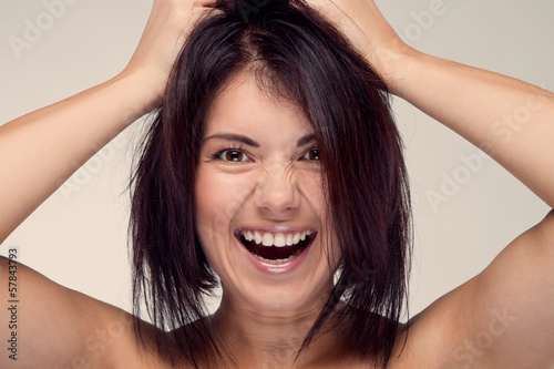portrait of screaming girls holding his hair (retro)