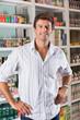 Happy Man Standing In Supermarket