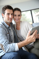Couple at home websurfing on the net