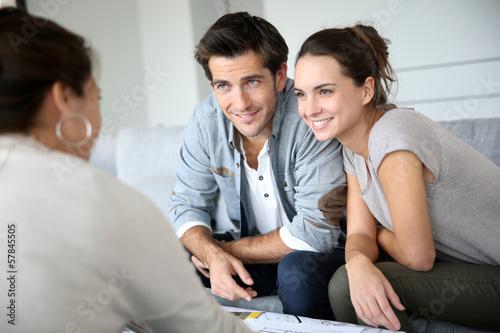 Leinwanddruck Bild Couple meeting architect for house construction