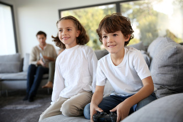 Kids at home playing video game