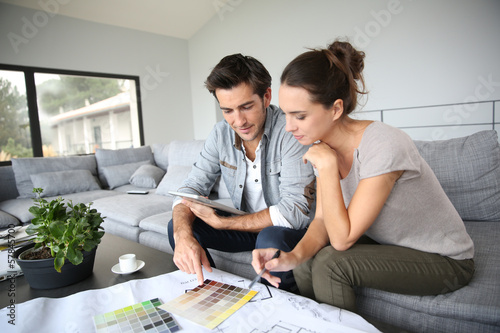 canvas print picture Couple searching ideas to decorate new home