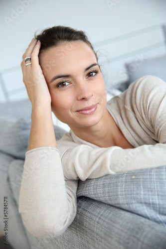 Gorgeous woman at home relaxing in living-room