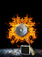 Guitar with loudspeaker on Fire
