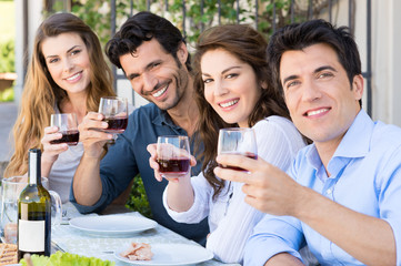 Friends Cheering With Wine Glasses