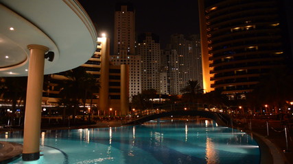 The swimming pool at luxury hotel in night illumination