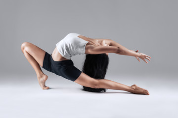 girl doing gymnastic poses in studio